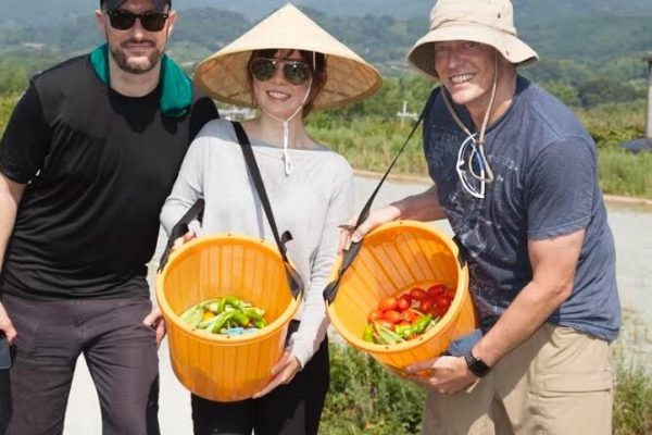 Students in the field with vegetables